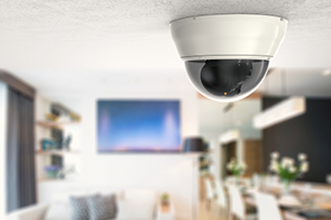 Dome shaped CCTV camera on ceiling